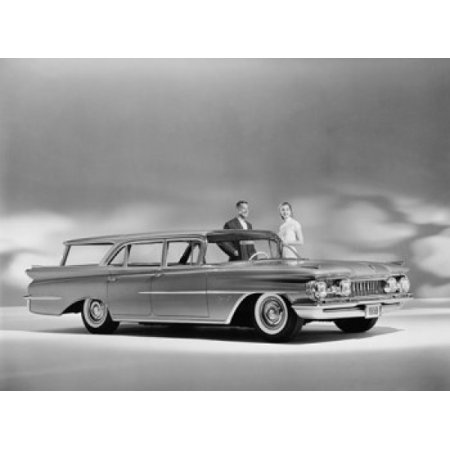 Man and a woman standing near a 1959 Oldsmobile Super 88 Fiesta Canvas Art - (18 x 24)