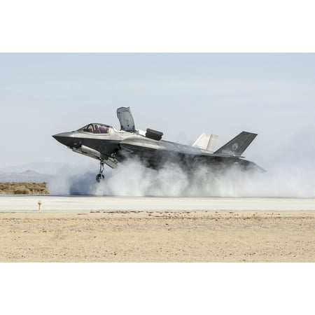 LAMINATED POSTER The Lockheed Martin F-35B Joint Strike Fighter completes a required wet runway and crosswind testing Poster Print 24 x 36