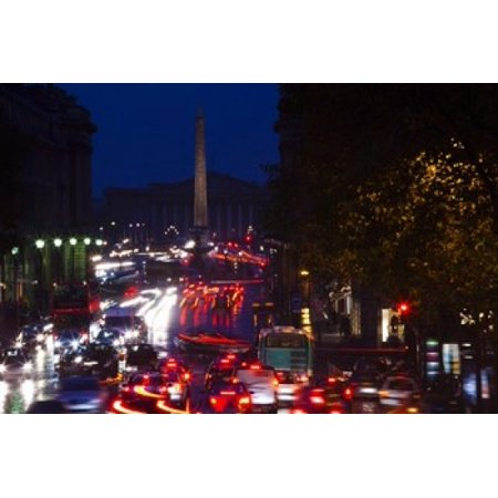 Elevated view of traffic on the road at night viewed from Eglise Madeleine church Rue Royale Paris Ile-de-France France Poster Print by Panoramic Images (36 x