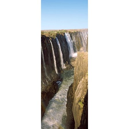Water falling through rocks in a river Victoria Falls Zimbabwe Canvas Art - Panoramic Images (18 x 7)