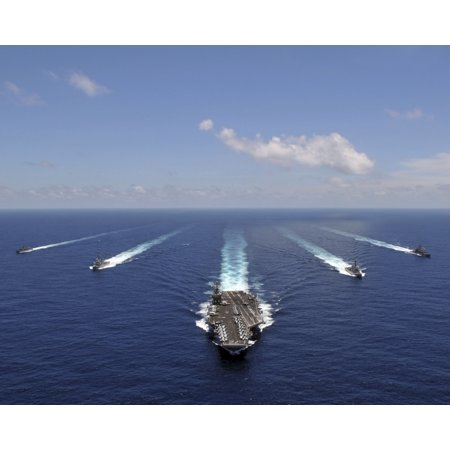 The aircraft carrier USS Abraham Lincoln leading a formation of ships from the Abraham Lincoln Strike Group Stretched Canvas - Stocktrek Images (31 x