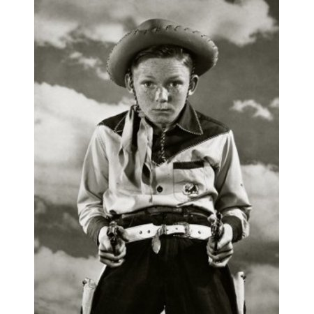 Boy in cowboy costume holding toy guns Canvas Art - (24 x 36)