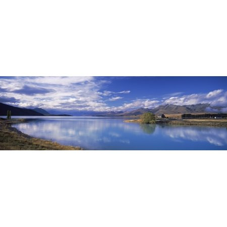 Fiordland National Park - Reflection of clouds in a lake Fiordland National Park South Island New Zealand Canvas Art - Panoramic Images (6 x 18)