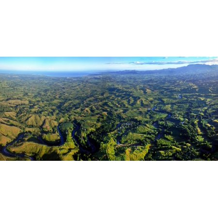 The Nadi River winds through the valleys forests and villages with the Sleeping Giant mountains and Nadi coastal town in the background as seen from 2000 feet high on an Adrenalin Fiji balloon (Best Coastal Towns In America)