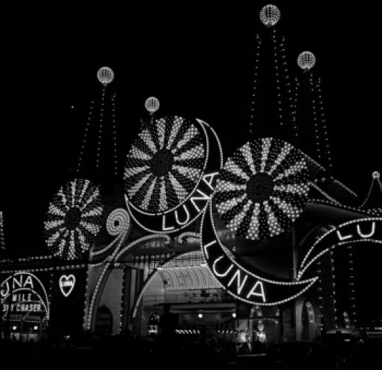 Neon lights in amusement park at night Poster Print