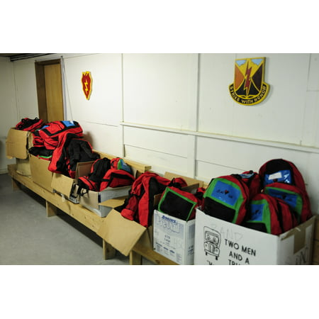 LAMINATED POSTER Backpacks filled with school supplies donated for Iraqi children at the Tirkrit Orphanage, sit on di Poster Print 24 x 36 - School Supplies For Kids