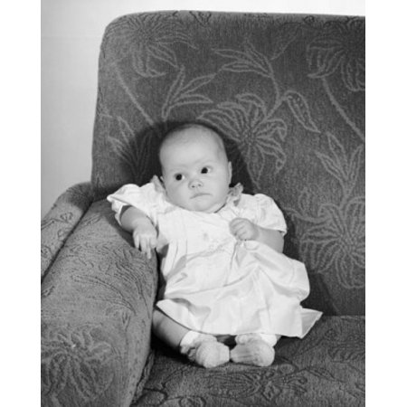 High angle view of a baby girl sitting on a couch Canvas Art - (18 x 24)