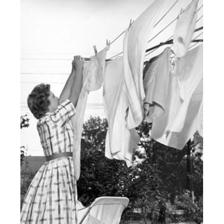 Young woman hanging clothes on a clothesline Stretched Canvas -  (24 x 36)