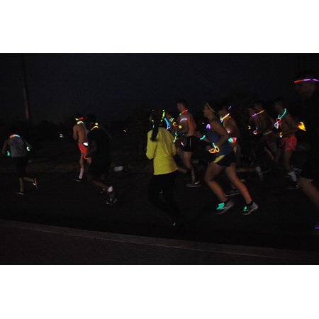 LAMINATED POSTER Members of the Wolf Pack participate in a 5k Glow Run during Lesbian, Gay, Bisexual, Transgender Pri Poster Print 24 x - Glow In The Night 5k