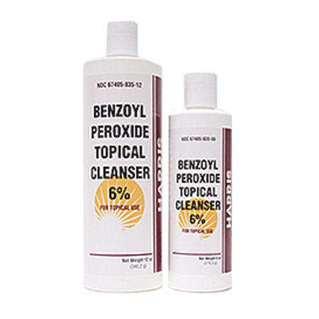 Benzoyl peroxide cleansing pads