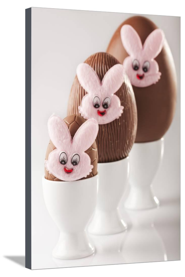 Chocolate Eggs with Bunny Faces in Egg Cups Stretched Canvas Print Wall Artwork By Martin Harvey by AllPosters