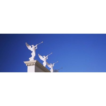 Low angle view of statues on a wall Caesars Place Las Vegas Nevada USA Stretched Canvas - Panoramic Images (36 x (Low Cut Caesar With The Deep Waves)