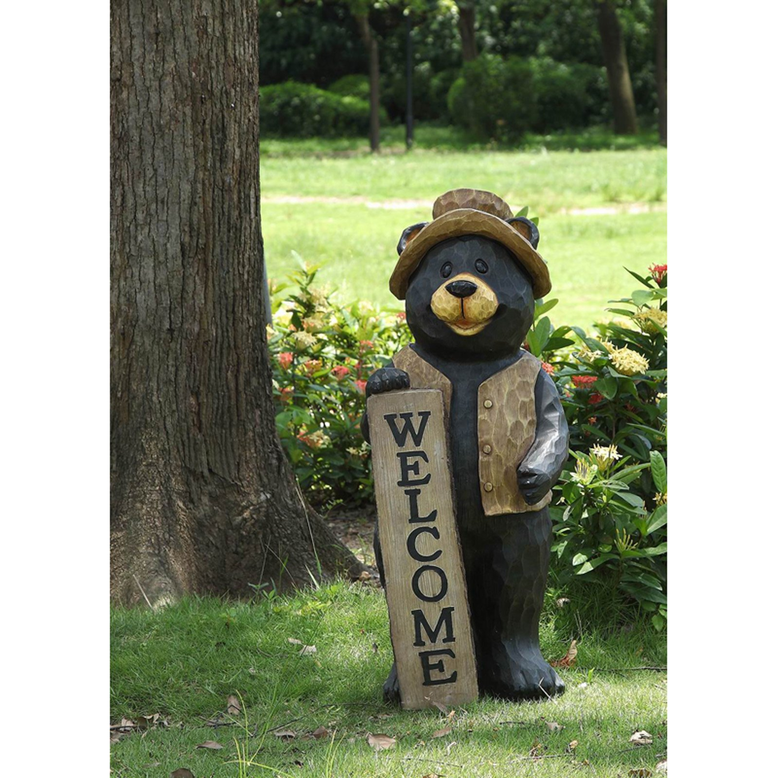 BEAR STANDING WITH A WELCOME SIGN