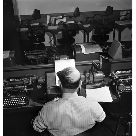 New York Times Office 1942 Na Telegraph Operator Receiving Western Union Dispatches In The Wire Room At The New York Times Office Photograph By Marjory Collins 1942 Rolled Canvas Art     18 X 24