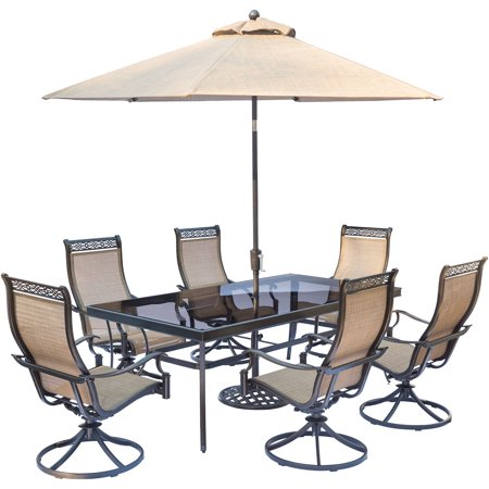 """Image of """"Hanover Monaco 7-Piece Dining Set with 6 Sling Swivel Rockers, a 42"""""""" x 84"""""""" Glass-Top Dining Table, and a 9 Ft. Umbrella with Stand"""""""
