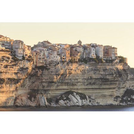 Old citadel townhouses and church at dawn, in early morning light, seen from the sea, Bonifacio, Co Print Wall Art By Eleanor Scriven