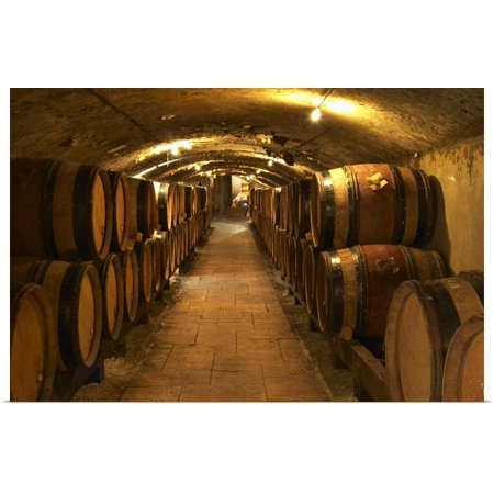 Great BIG Canvas | Rolled Per Karlsson Poster Print entitled Wooden barrels with aging wine in the cellar of Guigal in Ampuis, Cote Rotie, France