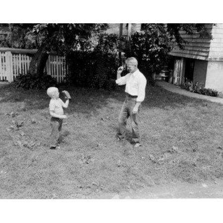 Father Throwing Ball To Son In Garden Poster Print
