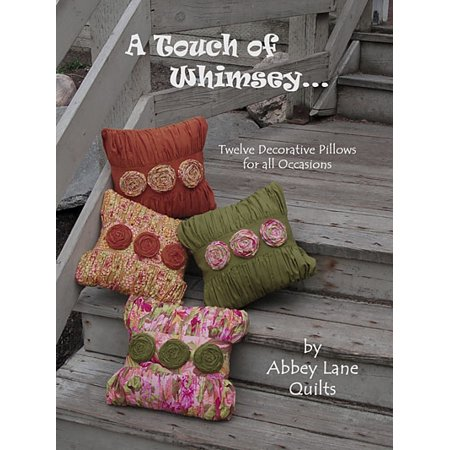 A Touch Of Whimsey Twelve Decorative Pillows for all Occasions24 page softcover book by Abbey Lane Quilts. Published by Abbey Lane Quilts. Full-sized fold-open applique patterns are staple in for easy removal. This book includes patterns and instructions for 12 unique pillows There are holiday pillows, decorator pillows, pillows to give away and pillows to display.