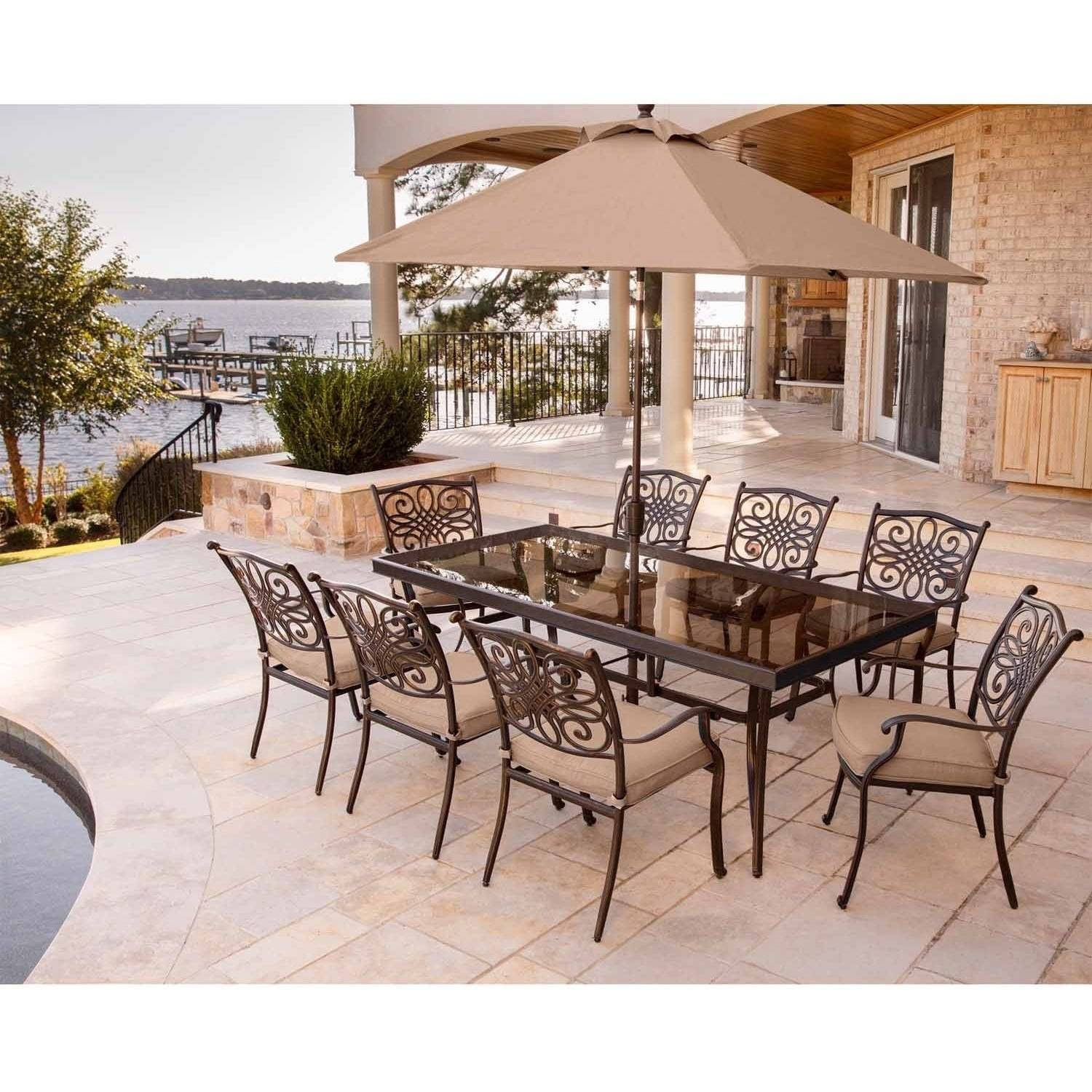 """Hanover Outdoor Traditions 9-Piece Dining Set with 42"""" x 84"""" Glass-Top Table, 8 Stationary Chairs and Umbrella with Stand, Natural Oat"""