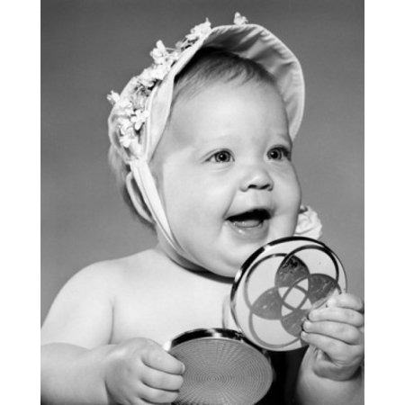Portrait of baby girl holding hand mirror Poster
