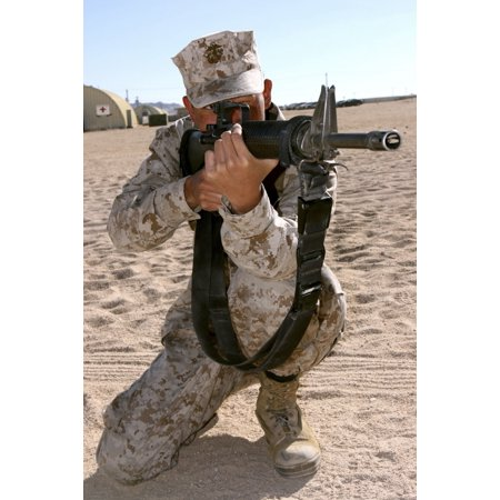 November 16 2006 - A Marine takes a knee while conducting squad rushes during Mojave Viper training at Camp Wilson Marine Corps Air Ground Combat Center Twentynine Palms California Poster (Average Temperature In Palm Springs In November)