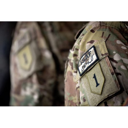 Big Red One patch on the uniform of a soldier assigned to the 1st Infantry Division Poster Print by Stocktrek Images