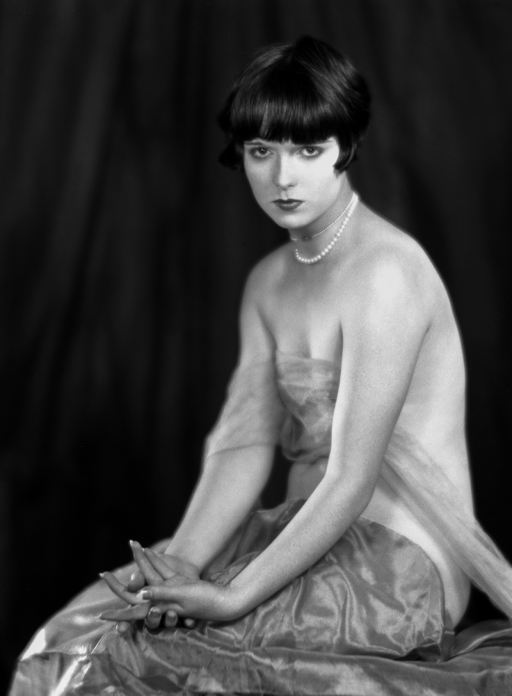 Louise Brooks sitting in Sexy Dress with Black Background