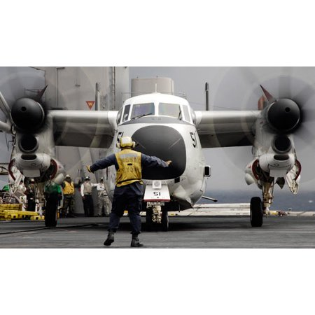An aircraft director guides a C-2A Greyhound aircraft across the flight deck Poster Print by Stocktrek (Best Poster Directors Posters)