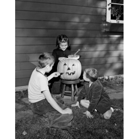 Boys and girl preparing pumpkin for Halloween party Stretched Canvas -  (24 x 36)](Preparing Pumpkins For Halloween)