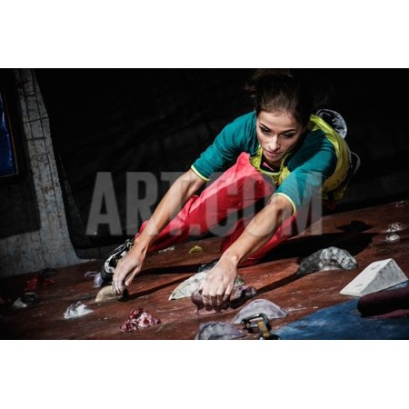 Young Woman Practicing Rock-Climbing on a Rock Wall Indoors Print Wall Art By NejroN Photo