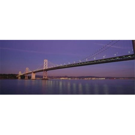 Low angle view of a bridge at dusk  Oakland Bay Bridge  San Francisco  California  USA Poster Print by  - 36 x 12 - image 1 of 1