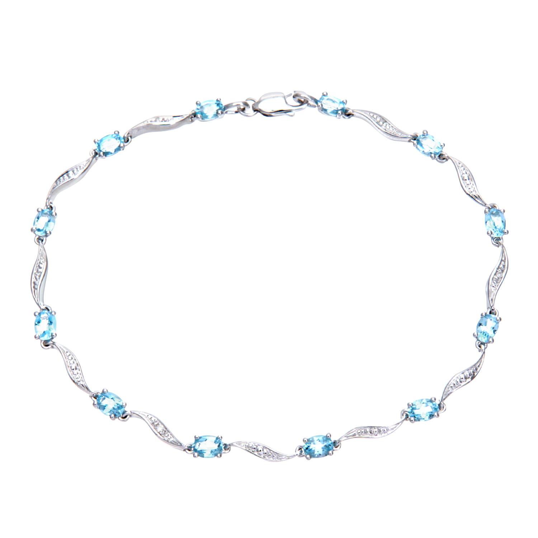 9ct White Gold Blue Topaz and Diamond Wave Link Bracelet by Revoni