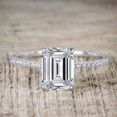 The Best 1.25 Carat Emerald cut Moissanite and Diamond Engagement