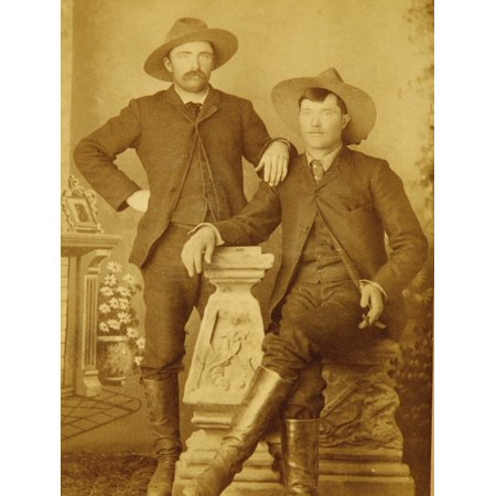Ranch Hands Dressed In Matching Suits And Elegantly Posed In Front Of A Faux Setting That Includes A Mantle Flowers And Decorative Frame The Seated Gentleman Even Sports A Cigar (Faux Ranch)
