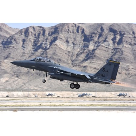 A US Air Force F-15E Strike Eagle from 366th Fighter Squadron 4th Fighter Wing taking off from Nellis Air Force Base Nevada during exercise Red Flag 2016-2 Poster Print