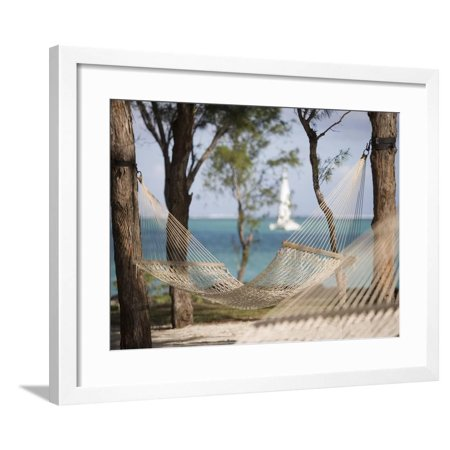Beach Hammock with Catamaran in Background, Private Island of Le Tuessrok Resort Framed Print Wall Art By Holger Leue