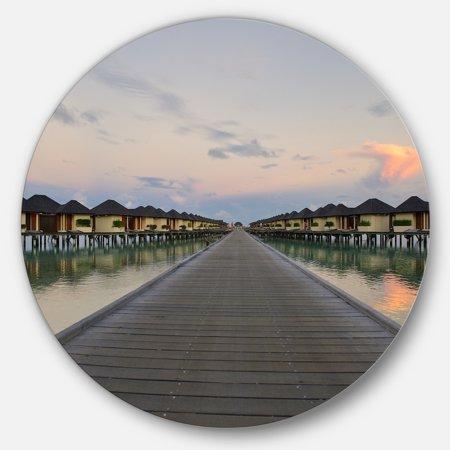 DESIGN ART Designart 'Wooden Bridge to Water Home Villas' Wooden Sea Bridge Round Wall Art