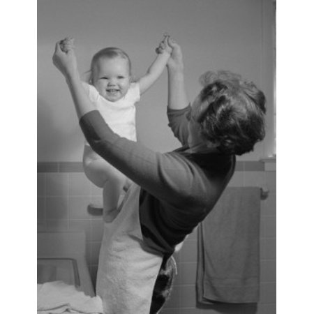 Mother playing with baby girl in bathroom Canvas Art - (18 x 24)