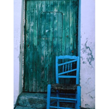 Chair in Front of a Green Door in the Village of Caceres, Caceres, Extremadura, Spain Print Wall Art By Jeffrey