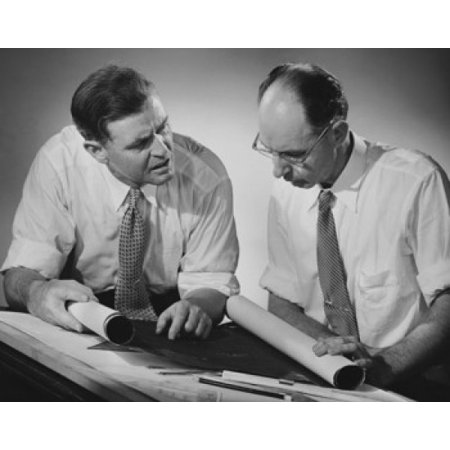 - Two architects discussing a blueprint Stretched Canvas -  (18 x 24)