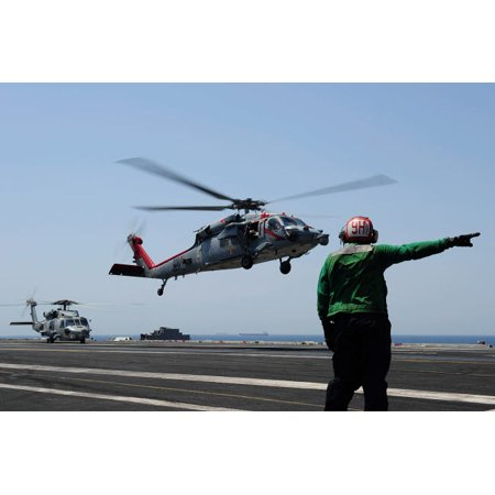An MH-60S Sea Hawk takes off from the flight deck of USS George HW Bush Poster Print by Stocktrek Images