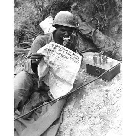 Us Soldier Reads The Latest News While Enjoying Chow During A Break In Battle Poster Print By Stocktrek Images
