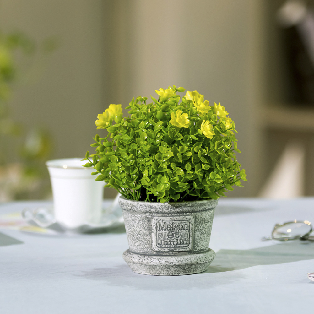 lifelike artificial plant, fake green leaves and yellow flowers
