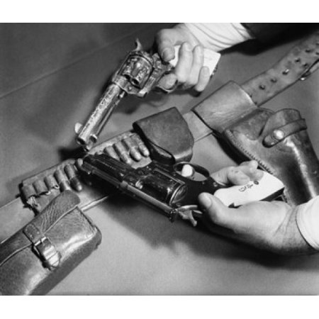Close-up of mans hands holding a 45 Caliber Colt Army Revolver with a Smith and Wesson 357 Magnum Revolver Canvas Art -  (18 x 24)