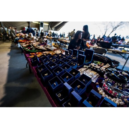 Jewelry is displayed on a table during the last bazaar at Transit Center at Manas, Kyrgyzstan, March Poster Print 24 x 36
