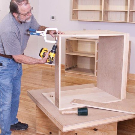 Woodworking Project Paper Plan to Build Hassle Free Workshop Cabinets