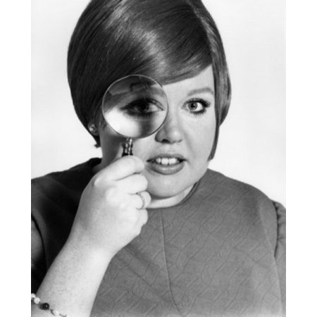 Studio portrait of teenage girl looking through magnifying glass Poster