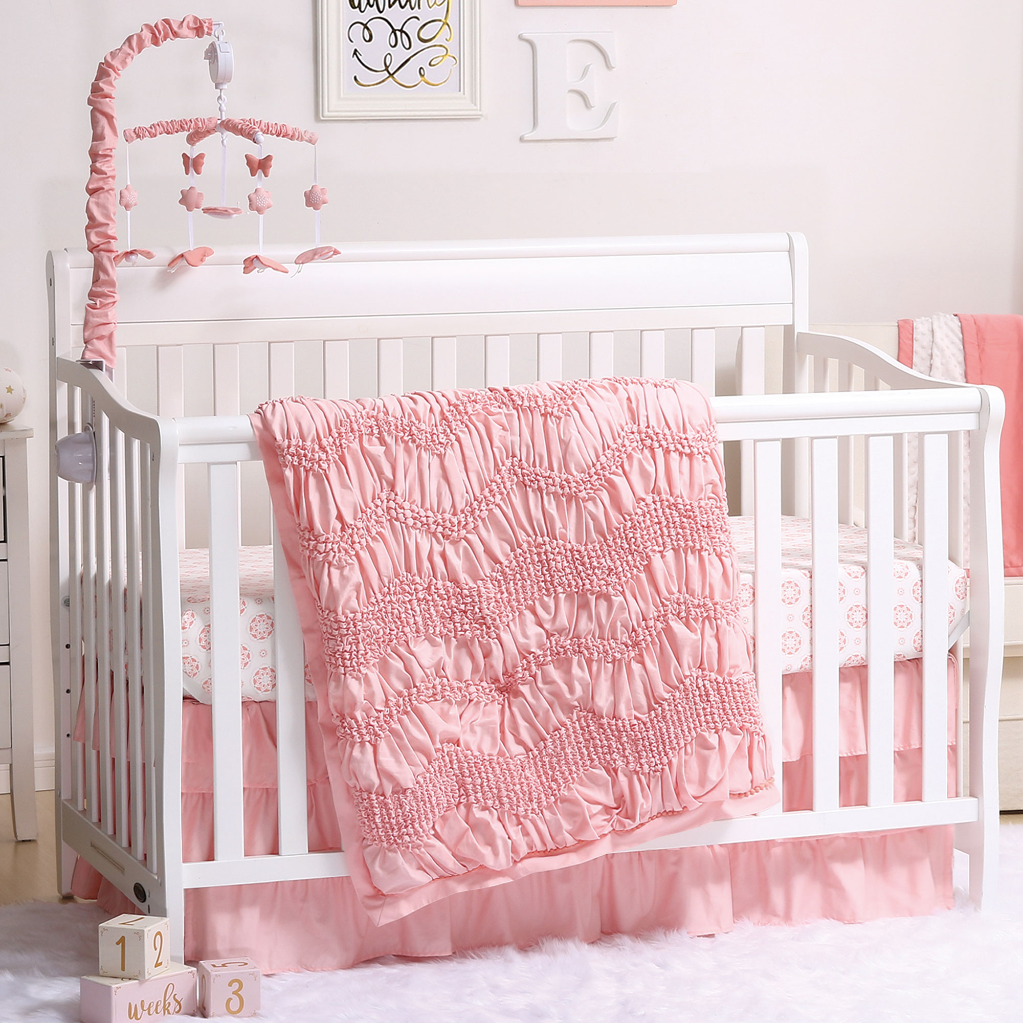 Jayden Coral Smocked 4 Piece Baby Crib Bedding Set by The Peanut Shell