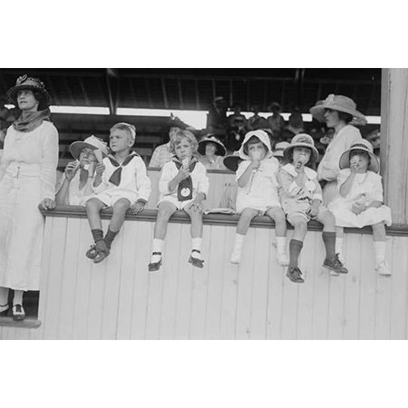 Children sit on wall in front of stands at the ballpark and eat ice cream cones.-Fine art canvas print (20